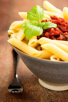 Penne pasta with a tomato bolognese beef sauce