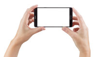 Female Hands Holding Smart Phone with Blank Screen on White