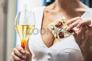 Girl with wine and chocolate