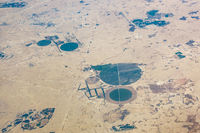 Aerial view of circular fields in the desert