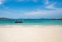 Boat on turquoise sea