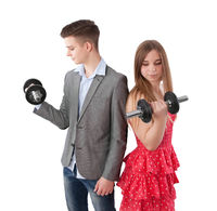 boy and girl with dumbbell