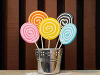 Five lollipops stacked in a metal pot