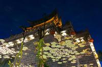 Lijiang Artistic Chinese Gate Water Reflection