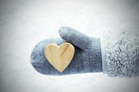 Wool Glove With Wooden Heart, Snow Background