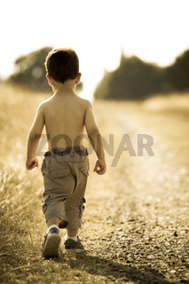 Young child walking on the road