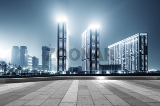 empty street with modern buildings in hangzhou qianjiang new city at night