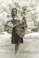 Woman in Dirndl in monochrome coloring