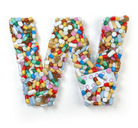Letter W. Set of alphabet of medicine pills, capsules, tablets and blisters isolated on white.