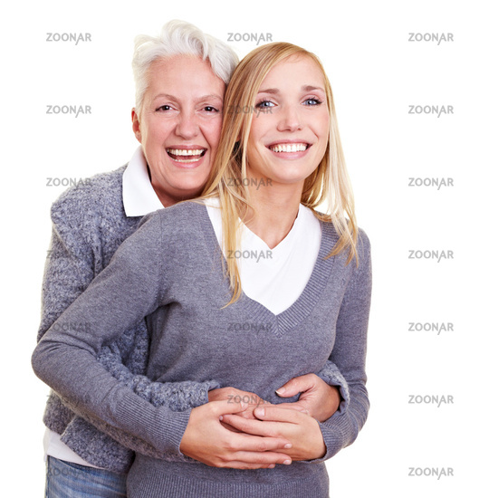 Grandma hugs her granddaughter