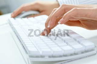 Female hand typing