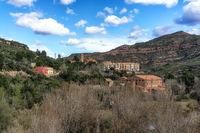 small village by montserrat mountain range