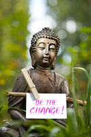 Buddha statue with the words Be the Change!