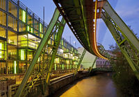 light streak of monorail suspension of Wuppertal over river Wupper in the evening, Germany, Europe