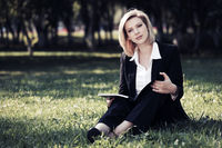 Young business woman with a folder on nature
