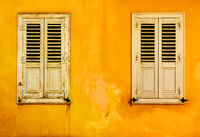 Yellow wall with two windows