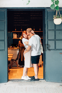 couple posing in the doorway