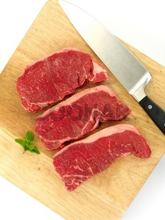 Porterhouse steak on a chopping board isolated against a white background