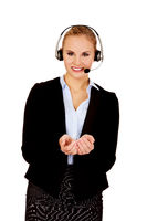 Young business woman in headset holding copyspace or something