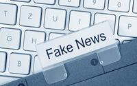 Fake News Folder on Computer Keyboard