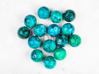 beads from natural Chrysocolla gemstone on gray