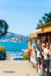 SF Cable Car Passengers Hanging Outside Platform