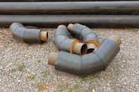 Pipes stacked in construction site ready for mount