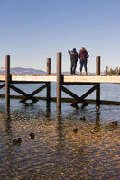 Two people sight see off dock Lake Tahoe