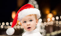 little baby boy in santa hat at christmas