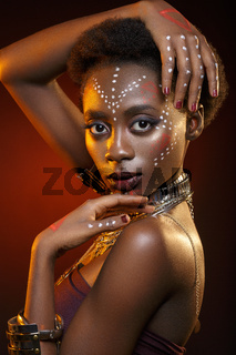 Beautiful afro girl with drawings on skin
