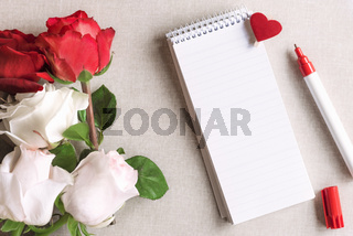 Roses and a blank spiral notebook with heart