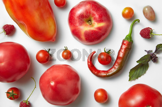 Red chili pepper and tomato .