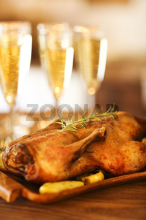 Christmas dinner with roast duck and champagne