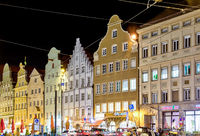Illuminated historic house facades in Augsburg at night