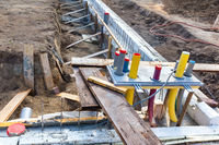 Foundation with pipes on construction site