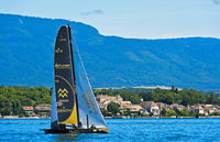 Sailing boat SUI 10 Ladycat powered by Spindrift Racing on Lake Geneva near Coppet, Switzerland