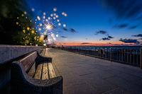 Empty bench on a seaside promenade at dusk