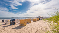 Sandy beach with beach chairs