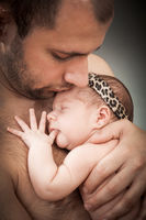 newborn child and father