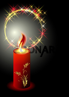 Burning candle with an ornament