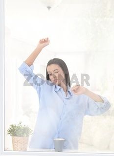 Woman stretching in morning light