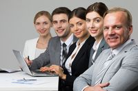 Business people sitting in a row