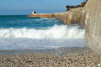 Wave breaking at Portreath Pier