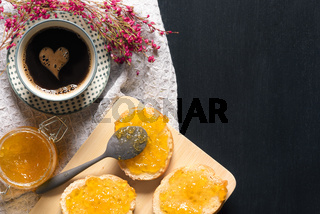 Coffee with heart shape and bread with jam
