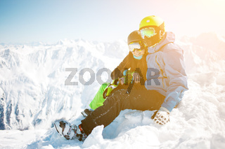 Couple hugging among winter mountain