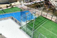 Tennis and basketball courts, view from above. Spain