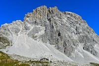 Mountain hut Carschinahütte beneath the south face of the Sulzfluh peak, St. Antönien, Switzerland