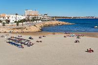 People sunbathing at the Cala Capitan beach. Spain