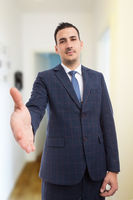 Real estate manager making handshake gesture as deal concept