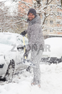 Man shoveling snow in winter.